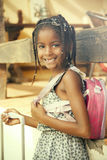 Happy african american little girl with backpack Royalty Free Stock Image