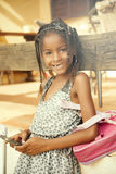 Happy african american little girl with mobile phone Royalty Free Stock Photography
