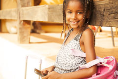 Happy african american little girl with mobile phone Royalty Free Stock Image