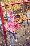 Happy African liitle girl in playground. stock images