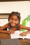 Happy african american little girl studying Royalty Free Stock Photo