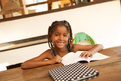 Happy african american little girl studying royalty free stock photos
