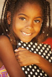 Happy african american little girl with tablet Stock Images