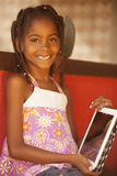 Happy african american little girl with tablet Royalty Free Stock Image