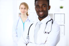 Happy african american male doctor  with medical staff at the hospital. Happy african american male doctor with medical staff at the hospital Royalty Free Stock Images