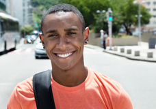 Happy african american male student in city Stock Photos