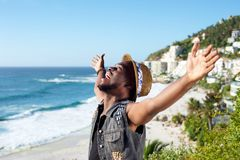 Happy african american man with arms outstretched Stock Images