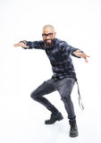 Happy african american man in glasses balancing and dancing Stock Photo