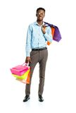 Happy african american man holding shopping bags on white backgr Royalty Free Stock Photography