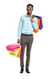 Happy african american man holding shopping bags on white backgr Royalty Free Stock Image