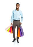 Happy african american man holding shopping bags on white backgr Stock Image