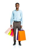 Happy african american man holding shopping bags on white. Background. Holidays concept Stock Photos