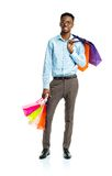 Happy african american man holding shopping bags on white. Holid Stock Photos