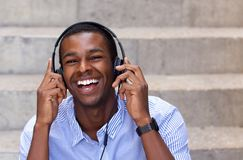 Happy african american man laughing with headphones Stock Photos
