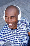 Happy african american man listening to music with headphones Stock Photography