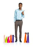 Happy african american man with shopping bags and holding credit Royalty Free Stock Image