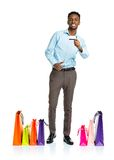 Happy african american man with shopping bags and holding credit Stock Photo