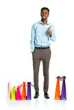 Happy african american man with shopping bags  Stock Photos
