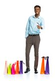 Happy african american man with shopping bags  Stock Photo