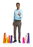 Happy african american man with shopping bags and holding credit Stock Images