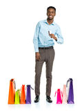 Happy african american man with shopping bags and holding credit Stock Image