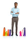 Happy african american man with shopping bags on white backgroun Stock Images