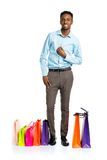 Happy african american man with shopping bags on white backgroun Royalty Free Stock Photography