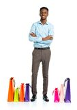 Happy african american man with shopping bags on white backgroun Stock Photo