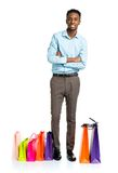 Happy african american man with shopping bags on white backgroun Royalty Free Stock Photos