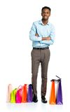 Happy african american man with shopping bags on white backgroun Royalty Free Stock Photo