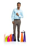 Happy african american man with shopping bags on white backgroun Royalty Free Stock Images