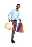 Happy african american man with shopping bags on white Royalty Free Stock Photography