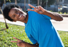 Happy african american man showing victory hand sign Stock Photo