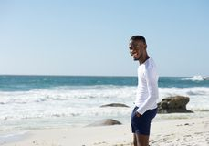 Happy african american man smiling at the beach Royalty Free Stock Photo