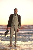 Happy african american man standing on the beach Stock Images