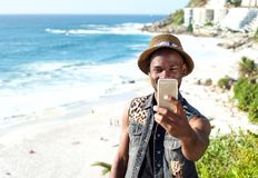 Happy african american man on vacation taking selfie Stock Photos