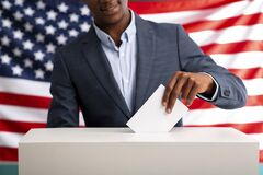 Free Happy African American Man Voting Inserting Paper Into Ballot Box Stock Photography - 178083022