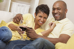 Happy African American Man & Woman Couple Drinking Wine Stock Photo