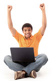 Happy african american man working on laptop. Royalty Free Stock Photography