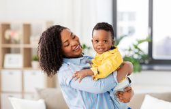 Happy african american mother with baby at home royalty free stock image