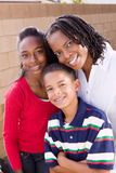 Happy African American mother and her children. Portrait of a happy African American family Royalty Free Stock Photography