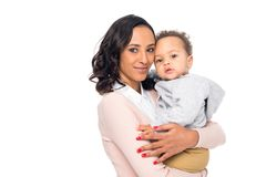 happy african american mother holding cute little child and smiling at camera royalty free stock image