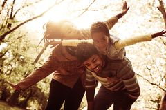 African American parents playing with daughter in nature. stock photography