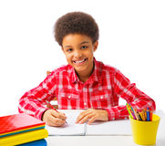 Happy African American school boy taking test Stock Photos