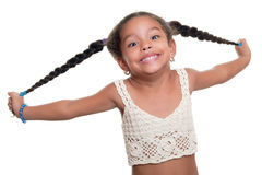 Happy african american small girl smiling and pulling her long b Stock Photography