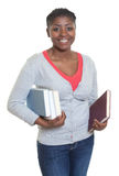 Happy african american student with books Royalty Free Stock Photos