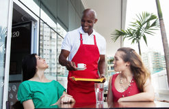 Happy african american waiter at work in a restaurant Royalty Free Stock Images