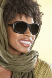 Happy African American wearing sunglasses with stole over her head Royalty Free Stock Images