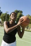 Happy African American Woman With Basket Ball Stock Photography