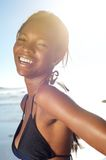 Happy african american woman at the beach in bikini Stock Photos